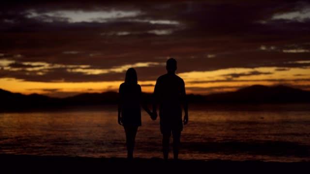 Couple enjoying a perfect sunset