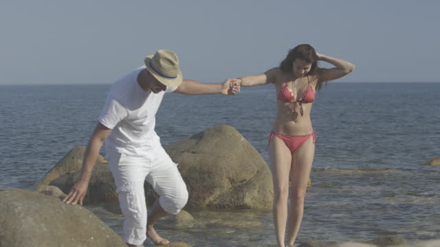 Couple enjoying beach vacation video