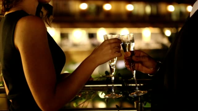 Couple enjoying champagne video