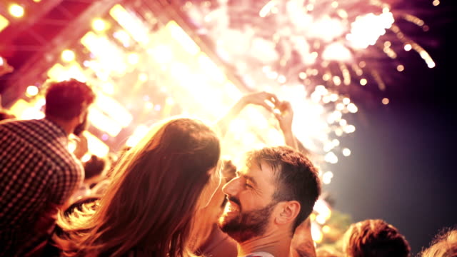 Couple enjoying fireworks display.