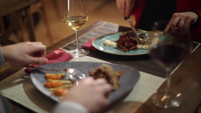 Couple enjoying in wine and dinner in restaurant