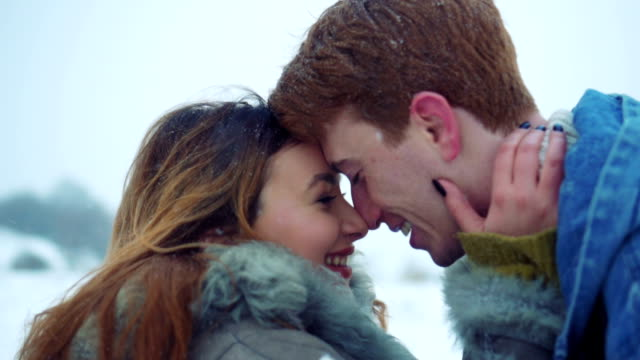 Couple enjoying love in winter nature video