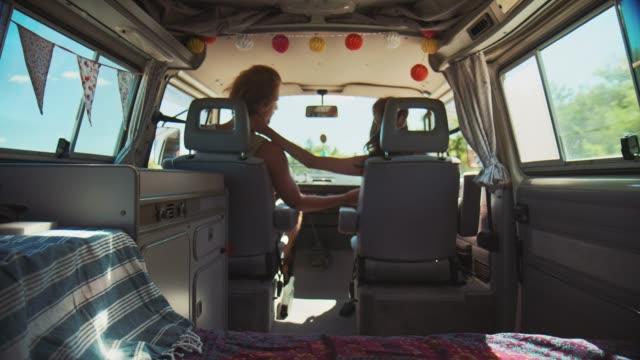 couple enjoying road trip during summer - furgone video stock e b–roll