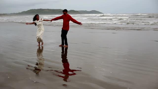 Couple enjoying summer near coastline video