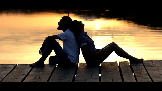 couple enjoying sunset at lake pier - lakes stock videos and b-roll footage