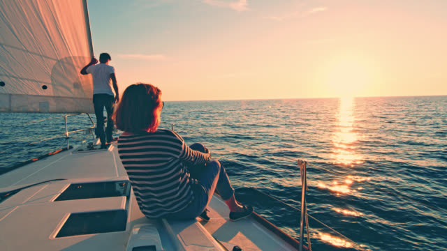WS Couple enjoying the sailing at sunset video