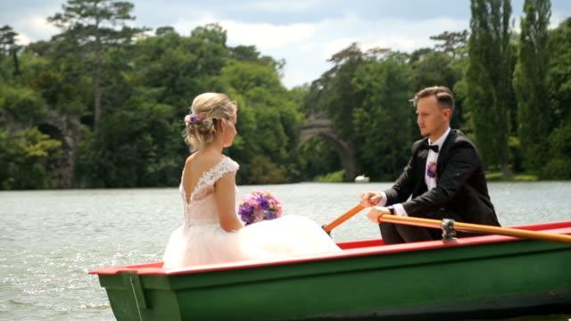 Couple enjoys paddling on the wedding day