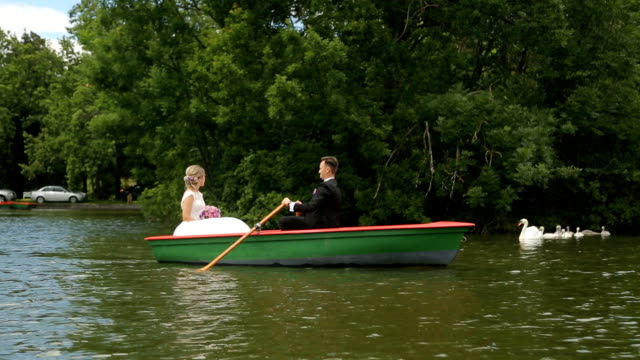 Couple enjoys rowing in nature