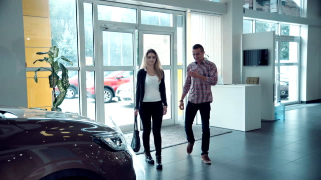 Couple entering in Car Dealership to chose car video