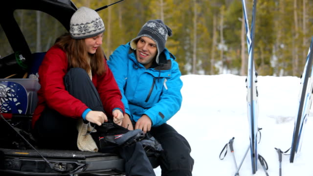 Couple getting ready to go cross country skiing video