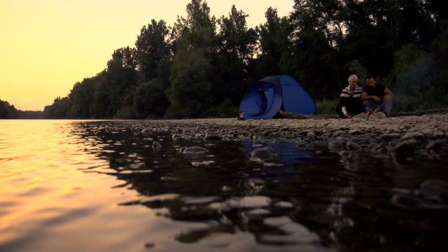 HD SLOW MOTION: Couple Having A Campfire At Sunset video