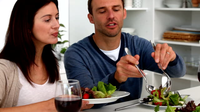Couple having a happy dinner video