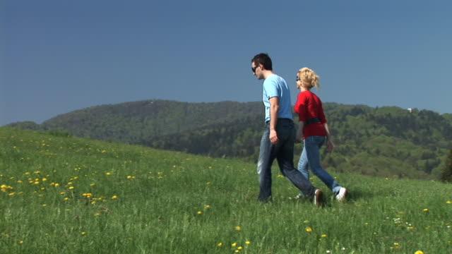 hd: couple having a walk - gå tillsammans bildbanksvideor och videomaterial från bakom kulisserna