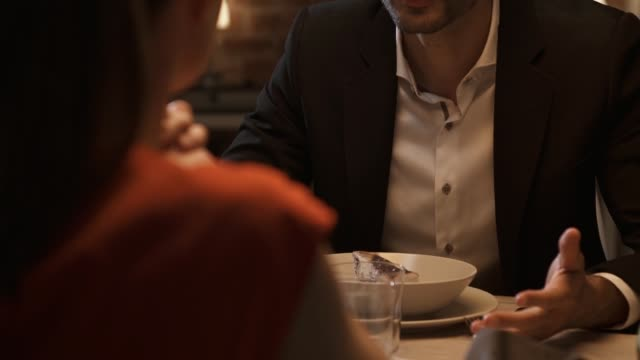 Couple having dinner and fighting at the restaurant Couple having dinner at the restaurant and fighting, they are aggressive and slap each other, relationship problems concept husband stock videos & royalty-free footage