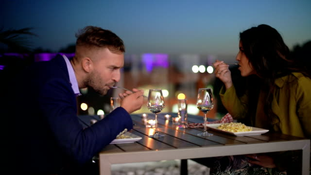 Couple having dinner outdoors video