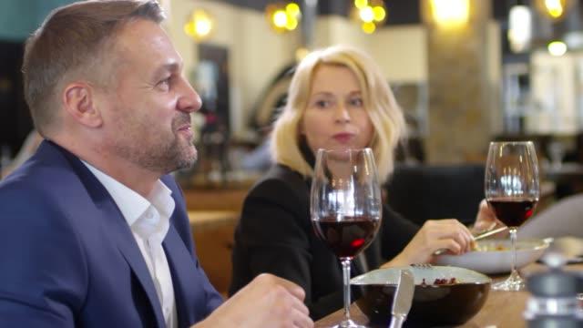 Bидео Couple Having Dinner