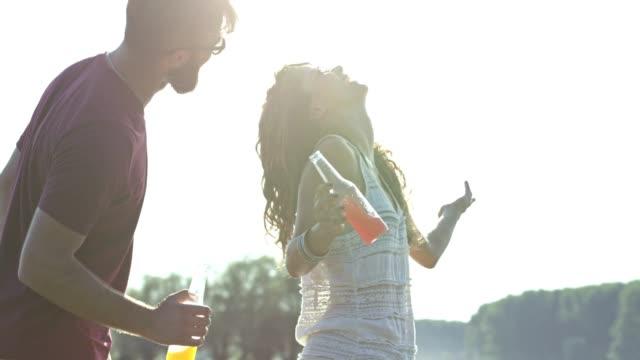 Couple having fun at the beach video