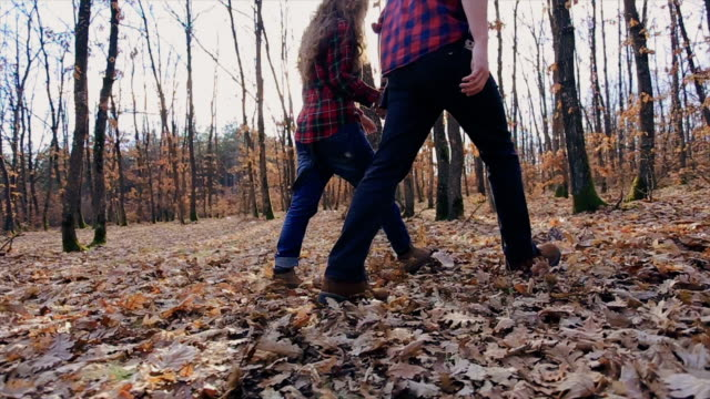 Couple having fun in forest, walking and fooling around video