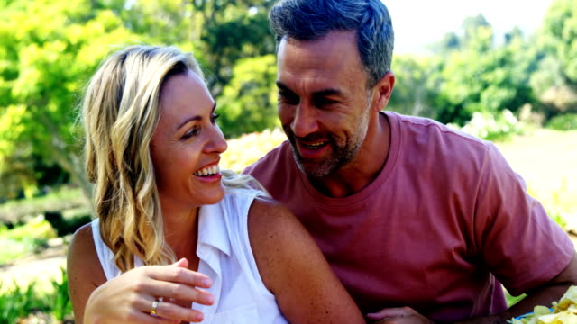 couple having fun in the park 4k - quarantenne video stock e b–roll