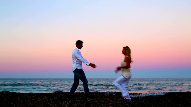couple having fun on the beach during the sunset video