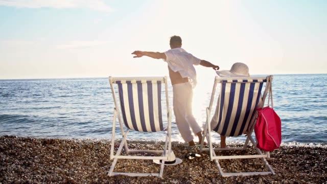 SLO MO Couple having fun on the beach
