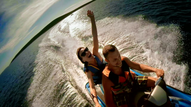 stockvideo's en b-roll-footage met pov couple having fun riding a jet boat - gopro