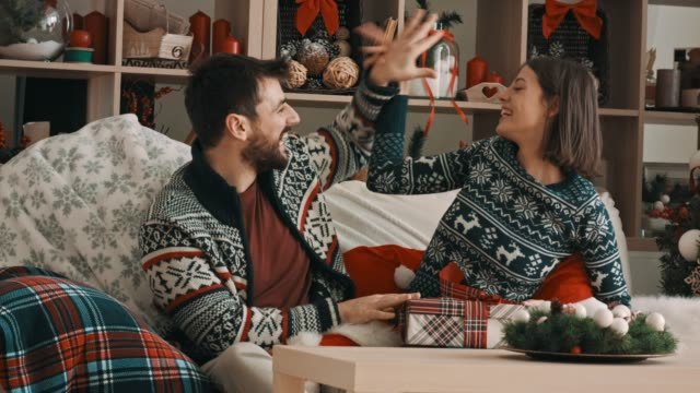 Couple having fun while taking Christmas themed photos together