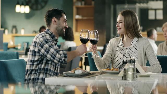 Couple having romantic dinner in restaurant video