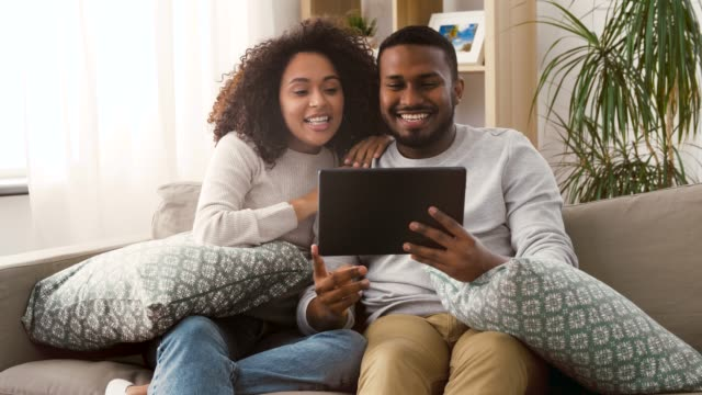 couple having video call on tablet pc at home - vídeo