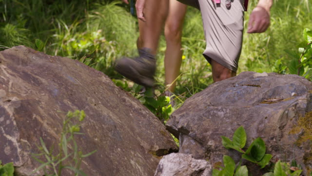 couple hiking, closeup of feet - hiking stock videos and b-roll footage