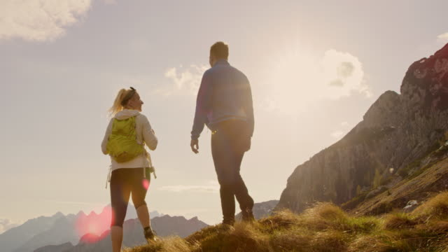 MS Couple hiking on sunny, majestic mountain video