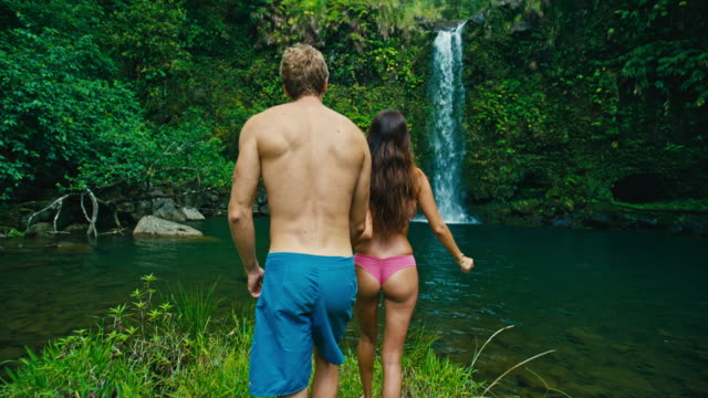 Couple Hiking to Waterfall video