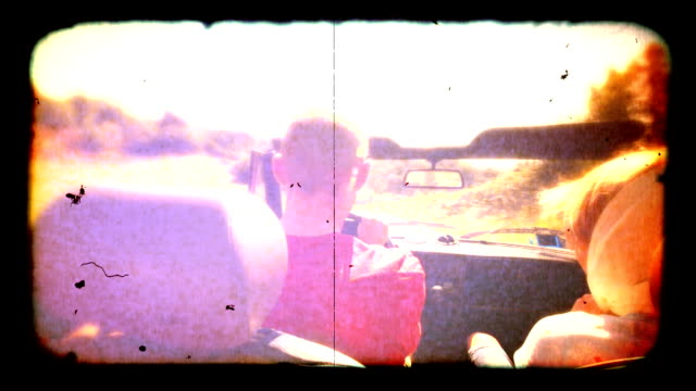 Couple in convertible car old film style. HD video