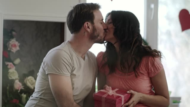 Couple in embrace kissing and sharing affectionate moment on Valentine's day