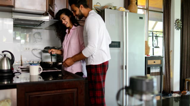Couple In Kitchen, Man Embrace Woman Cooking Breakfast Talking Young Happy Family Morning Communication video