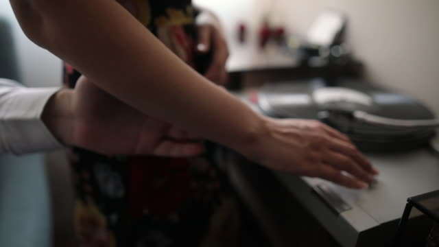 Couple in love holding hands in their living room while listening to music on old turntable video