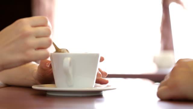 vídeos de stock e filmes b-roll de couple in love in cafe - coffee table