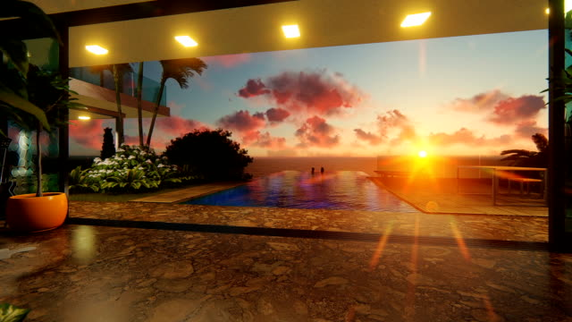 Couple in swimming pool, luxurious villa against beautiful sunset