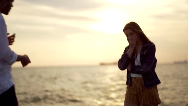 Couple is having problems in relationship Young couple is standing near the sea at sunset and arguing. human relationship stock videos & royalty-free footage