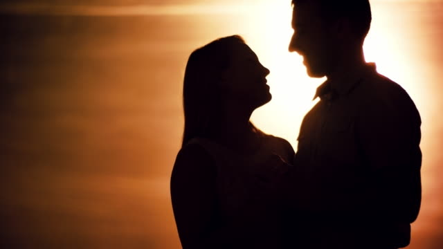 Couple Kissing at Sunset video