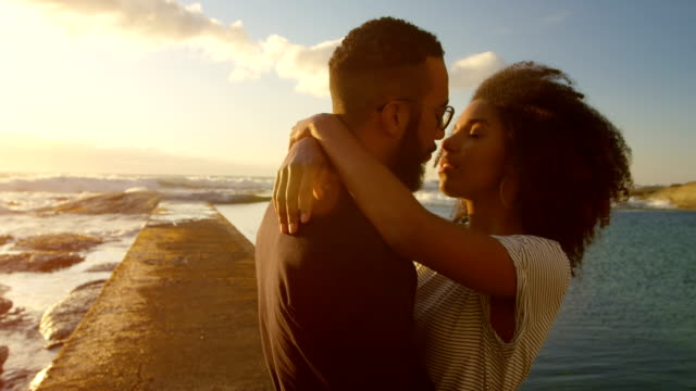 Couple kissing each other on the beach 4k Couple kissing each other on the beach at dusk 4k kissing stock videos & royalty-free footage