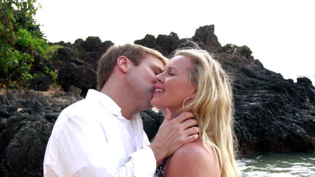 Couple kissing on beach in Hawaii video