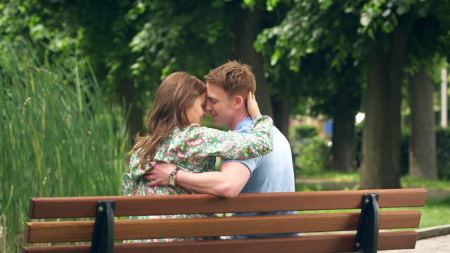 couple kissing on bench - bench stock videos & royalty-free footage