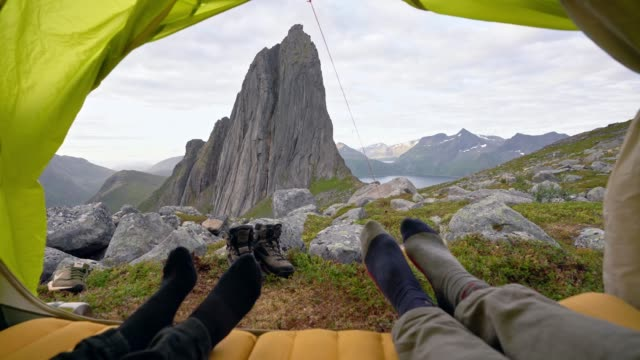 Couple laying in tent on Senja Island in  mountains