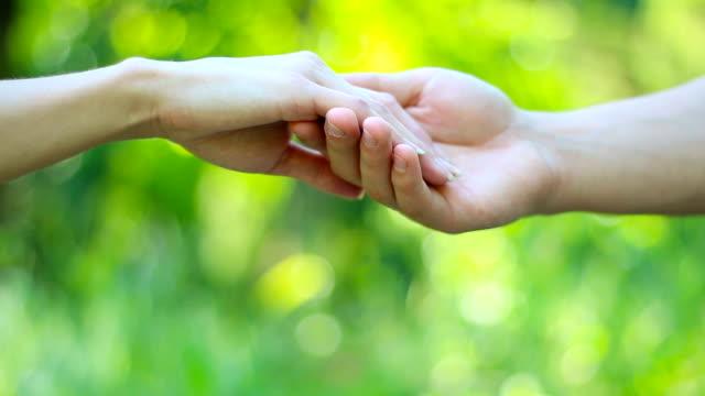vídeos de stock e filmes b-roll de couple let go of each other's hands - mulher deixar ir