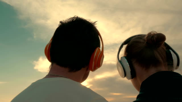 Couple Listening to Music Outdoors video