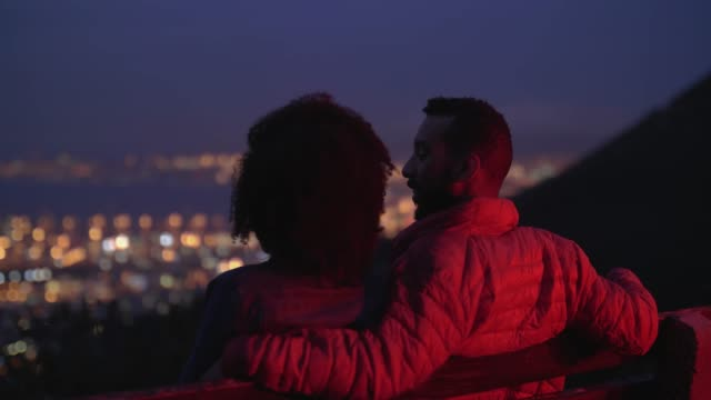 couple looking at big city lights, urban landscape at night - date night stock videos & royalty-free footage