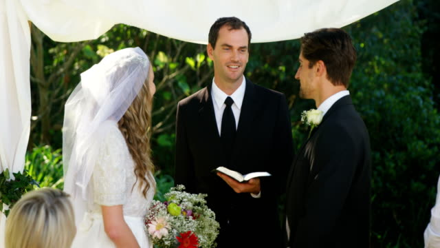 Couple looking at each other during wedding 4K 4k video