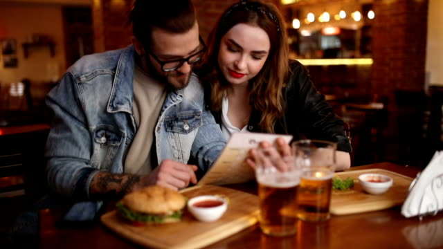 couple looking in a menu at the pub - couples stock videos and b-roll footage