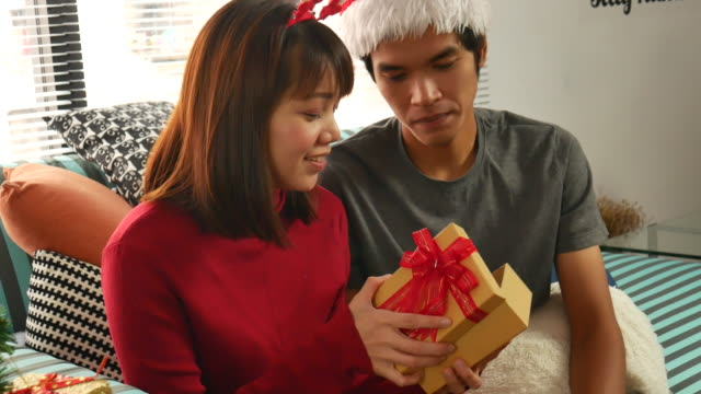 couple love open the christmas gift video